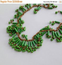 STOREWIDE SALE Art Deco Necklace. Haskell Style Green Glass with Flowers. by pinguim on Etsy https://www.etsy.com/listing/161513032/storewide-sale-art-deco-necklace-haskell