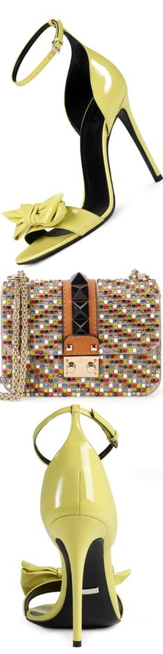 Gucci Clodine Patent Leather Sandal, shown in Yellow and Valentino Crystal Mini Rockstud-Trim Flap Bag, shown in Multicolor