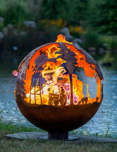 Appel Crisp Farms - 37″ Fire Pit  Sphere made in the USA with American made steel. Features the various farm animals found on our hobby farm in Ohio. First came the ducklings as a Christmas gifts to the children, then came the baby chicks. They both quickly turned into ducks and chickens. It wasn't long before the Dexter cow (Beauty) and the KuneKune pigs (Matt Dillon & Miss Kitty) arrived.