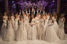 Debutantes and their escorts pose for pictures ahead of the Queen Charlotte's…