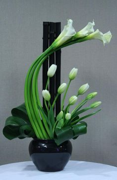 Forever elegant calla lilies and tulips - dramatic arrangement.