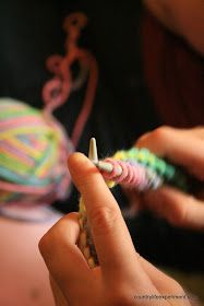 Teaching knitting to children using a rhyme. In through the front door, run around the back, back through the window, and off jumps Jack.