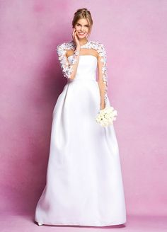 This Angel Sanchez wedding dress with floral appliqués on the sleeves adds a playful touch to any wedding look.