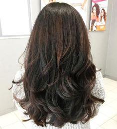 Haare oben schwarz unten braun