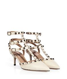 The classic kitten heel gets the covetable rockstud treatment with this tough-meets-chic pair from Valentino #Stylebop € 950