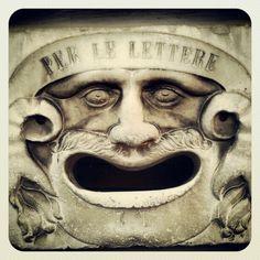 Strange mailbox in a street of Pisa, Tuscany