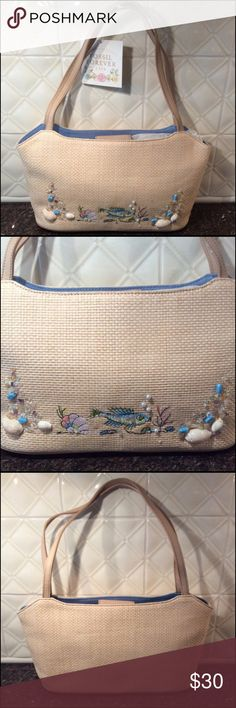 Adorable Fossil Summer Handbag The cutest faux straw summer handbag. Tan handles that can be worn over shoulder. The length of one handle is 20 inches. The front is so cute with the ocean fish  scene. See photo. There is a snap closure in the center. The interior is a pretty blue. Like the ocean blue. One zip pocket inside. Width at the top is 14 inches. Depth is 7 1/2 inches.  There are four silver stud feet on bottom of bag. Perfect for a summer vacation at the beach.  bundle and save 20%…