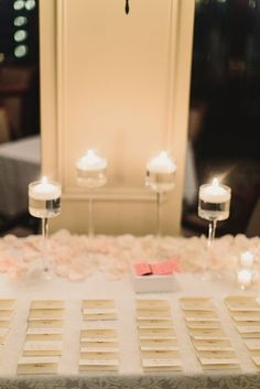 Love this soft delicate look for our escort card table.  A classy way to spice it up!