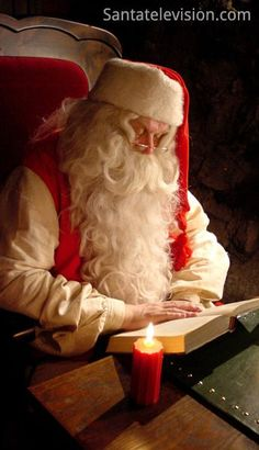 Santa Claus in Rovaniemi in Lapland reading a book