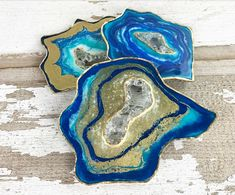Create sparkling faux geode coasters! Tint ArtResin with Golden Fluid Acrylics, and add glitter, gold leaf, and crystal elements to make one-of-a-kind mixtures!