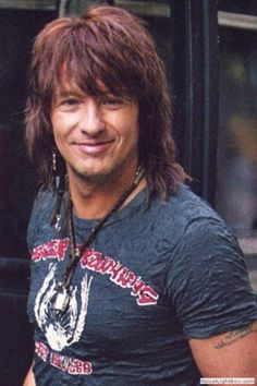 Richie Sambora is an American rock guitarist, producer, singer and songwriter who was longtime lead guitarist of the rock band Bon Jovi for thirty years. He and frontman Jon Bon Jovi formed the primary songwriting unit of the band. He is the ex-husband of Heather Locklear.