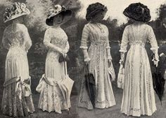 The Edwardian lady: lingerie dress, big hat, and parasol. Looks mid-late 1900s.