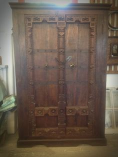 Large hand carved Teak double door armoire from India. @tampabaysalvage Architectural Salvage and rare finds from across the globe.  Antique house parts, industrial, nautical, wrought iron, stained glass, hardware, vintage home decor.     www.tampabaysalvage.com