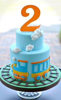 Little Train Cake but with boy in blocks on top