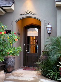 A $20 resin garland painted to match the house elevates this arched doorway.