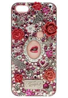 Flaunting the unique Crystyled design concept, the Fleurt iPhone 5 case from the Vintage collection features a sexy blend of Swarovski elements and feminine themed charms. A seductive pink lips cameo with an Eiffel tower, a key, hearts and flowers set against a pink background give this piece a flirty and girly appeal.
