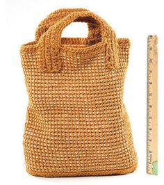Nice Tunisian Crochet bag.  I would change the handles to leather and add a closure.  Free Lion Brand pattern!