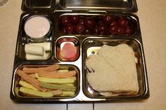 02-23-12 - classic lunch that you would often find in a kiddo's lunch box.. just done bento style :) - Jelly sandwich, veggie straws, grapes, yogurt, cheese stick & candied peach