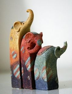 Elephant Vignettes...would be neat (or something similar) on a bookshelf or cabinet with lights on them...
