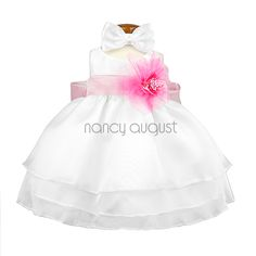 White Organza Layered Baby Dress: This sassy white organza layered baby dress features a sensational sleeveless style with a triple layer skirt. This beautifully simple organza tea length dress comes with a a adjustable sash tie in the back. Like many of our special occasion dresses, it is versatile and can be used as a flower girl dress, pageant dress, or even as a holiday party dress. No matter the occasion, this will make your little flower girl even more adorable and irresistibly…