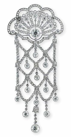 A BELLE EPOQUE DIAMOND BROOCH. The openwork fan-like surmount with old-cut diamond collet highlights within a millegrain-set rose-cut diamond frame, suspending an articulated similarly-set trellis like panel with diamond single-stone drop terminations, circa 1915. #BelleÉpoque #brooch