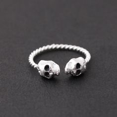 silver skull ring with twisted ringline