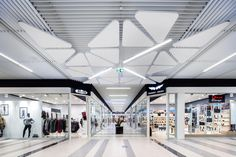 Optima L Canopy by Armstrong Ceiling Solutions Corridor Lighting, Ceiling Design, Ceiling Ideas, Corridor Design, Mall Design, Shopping Malls, Canopy, Department Store, Flooring