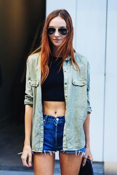 So cool off-duty in cutoffs, a crop, and aviators. #Offduty #NYC