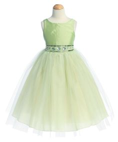 Lime Green Flower Girl Dress with Rhinestone And Tulle Skirt: This gorgeous lime green rhinestone flower girl dress features a taffeta bodice and tulle skirt with additional netting underneath for a full volume ballerina skirt look. The waistline is embellished with elegant green rhinestone jewels, delicate beading, and sequin. Your little princess will be the belle of the day in this exquisite lime green flower girl dress.