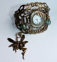 Fantasy watch with fairy charm by Pinkabsinthe  http://www.etsy.com/shop/pinkabsinthe