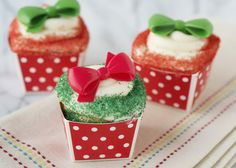 Christmas gift cupcakes, topped with a cupcake ring bow.
