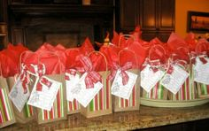 instead of buying christmas gift bags, buy a pack of brown bags and glue christmas paper onto them.  I love this idea.