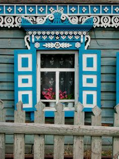 Cheerful turquoise and white house trim.  Looks Scandinavian but I have no source.