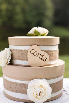 What a cute way for guests to write down wisdom & wishes for the bride & groom and then put them in the box!!  Burlap rustic round tiered card box.