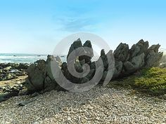 A view of pebble beds and granite spiky rock formations at an eastern cape beach in South Africa.