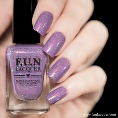 Esmalte lilás holográfico   4AM' is a periwinkle purple holographic polish with red/copper shimmer and gold holographic micro glitter