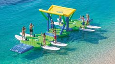 This is one of the most fun ideas we've seen in a while. It's like a floating bouncy castle food truck for SUP boards rentals, vacation and recreational spots. The Wibit SUP Docking Station is great for… Sup Stand Up Paddle, Sup Paddle, Sup Surf, Party Barge, Floating Dock, Sup Boards, Sup Yoga, Standup Paddle Board, Bouncy Castle