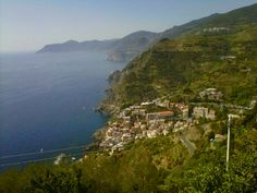 Cinque Terre, Italy for hikers and those who love the old Italy.  Most wonderful seafood, people and expresso!