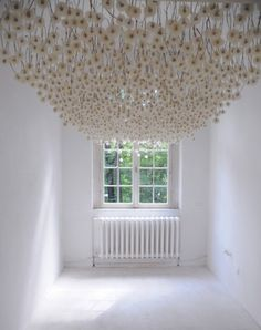 Installation by German artist Regine Ramseier, who preserved and hung 2,000 dandelion seed heads from the ceiling.