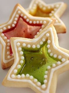 Jewel Cookies are easy to make - Make a batch classic sugar cookies and cut out the center, Fill the empty space with crushed hard candies that melt when baked to create clear gem-like centers. Also known as 'stain-glass cookies'. Either way they are beautiful!