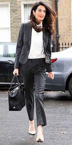 Mrs. Clooney's first career may be law, but her second is looking stunning every time she leaves the house. Her signatures? Lots of statement accessories (Bold sunnies! Quirky shoes!) and an absolu…