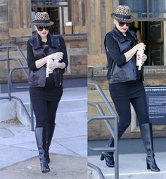 Pregnant Gwen Stefani out on a Christmas shopping spree buying toys and wearing all-black with a black leather waistcoat, knee-length boots, sunglasses, and an animal-print hat in Los Angeles on December 17, 2013