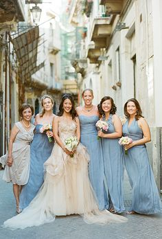 Mismatched dresses.   Amsale blue floor-length bridesmaid dresses (Photo: Kate Headley)