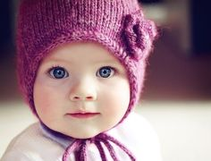Blue-eyed baby with a pink knit hat