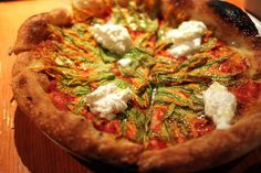 Squash blossom and burrata cheese pizza.... hollly moly