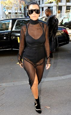 Showing Skin from All the Kardashians' Paris Fashion Week Looks  The oldest Kardashian sister strutted in a black bodysuit and black sheer overlay.