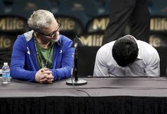Manny Pacquiao (R) of the Philippines hangs his head as his trainer Freddie Roach looks on during a post-fight news conference after losing to Floyd Mayweather Jr. of the U.S. at the MGM Grand Arena in Las Vegas, Nevada May 2, 2015. Mayweather took Pacquiao's WBO title with a unanimous decision. REUTERS/Richard Brian