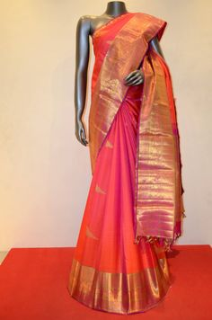 Peach Orange Kanjeevaram Silk Saree With a Grand Traditional Zari Border Product Code: AB213073 Online Shopping: http://www.janardhanasilk.com/index.php?route=product/product&search=AB213073&description=true&product_id=4377