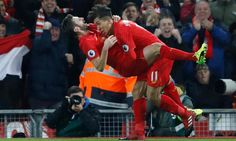 Firmino celebrates scoring their second goal with Lallana.