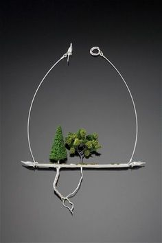 """Underneath It All  2010  sterling silver, model railroad landscape materials  10"""" x 7"""" x .5""""  one-of-a-kind  collection of Racine Art Museum"""
